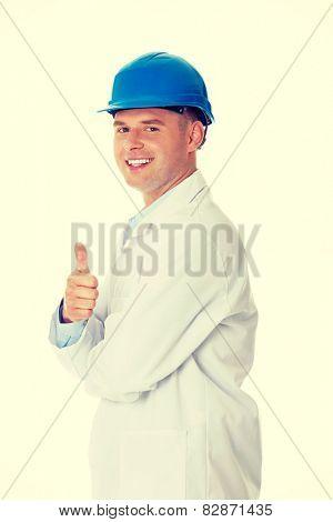 Man in a lab coat and helmet, engineer, teacher or chemical gesturing OK
