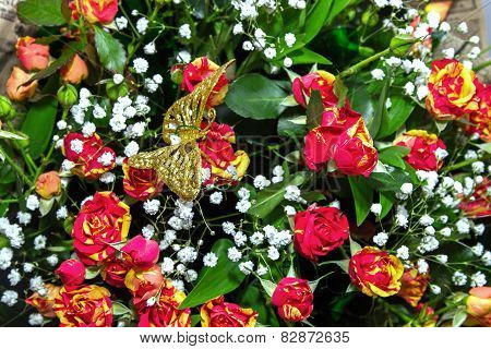 Background From A Bouquet Of Roses And Butterfly On Top