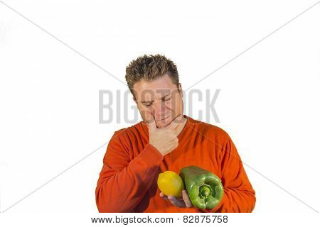 Thoughtful Man Holding Fruits And Vegetables