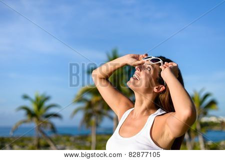 Joyful Young Woman On Tropical Caribbean Travel Looking Up