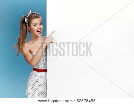 Excited woman showing empty blank banner with copy space for text