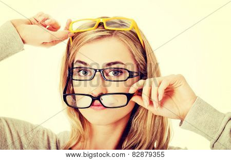 Young woman checking new  eyeglasses