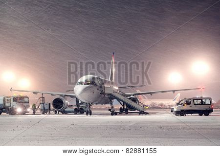 Moscow, Russia, February, 09,2015: commercial airplane parking at the airport in winter