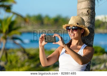 Woman On Caribbean Travel Taking Photo With Smartphone