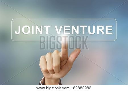 Business Hand Clicking Joint Venture Button On Blurred Background