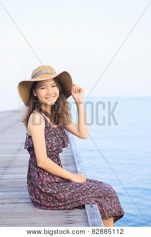 Portrait Of Beautiful Woman Wearing Long Dress And Straw Hat Looking To Camera Use For People Vacati