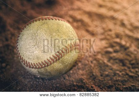 A baseball on the ground