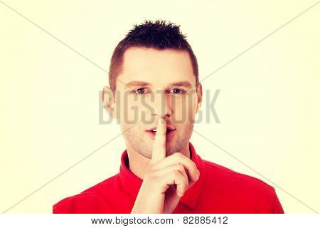 Mangesturing to be quiet with finger