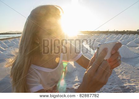 Woman making self portrait on sunset