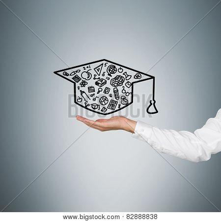 Hand Holding Bachelor Cap
