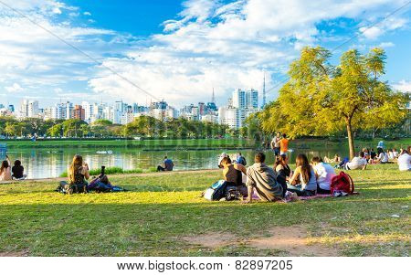 SAO PAULO, BRAZIL - CIRCA AUGUST 2014: People enjoy a hot day in Ibirapuera Park. Ibirapuera Park is the largest park in Sao Paulo, Brazil.