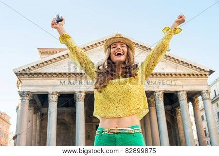 Portrait Of Happy Young Woman With Photo Camera Rejoicing In Front Of Pantheon In Rome, Italy