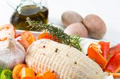 stock photo of raw chicken sausage  - Baked chicken stuffed with fresh raw vegetables - JPG