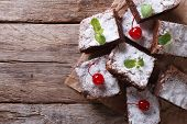 picture of brownie  - brownie cake with mint and cherry on paper - JPG