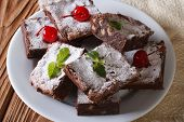 image of brownie  - chocolate cake brownie with walnuts and cherries close - JPG