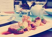 image of duck breast  - Medium rare fried duck breast with fried onion and sauerkraut - JPG