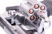 stock photo of ammo  - Macro shot of an open revolver loaded with bullets - JPG