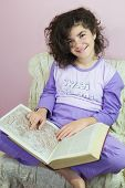 picture of ten years old  - Ten year old girl in pajamas and old encyclopedia - JPG