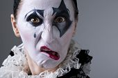 foto of mimicry  - Woman in disguise harlequin in the studio - JPG