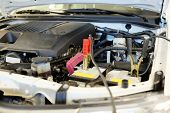 picture of internal combustion  - The image of a car with open hood - JPG