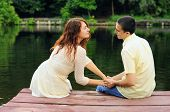foto of pier a lake  - Couple of young lovers hugging on the pier of the lake - JPG