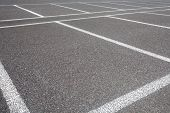 stock photo of parking lot  - Empty Space in a car parking Lot - JPG