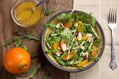 image of mandarin orange  - Closeup of a plate of arugula salad with mandarins oranges beans sprouts and sliced almonds served with mandarin vinaigrette for healthy lunch - JPG