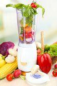 picture of blender  - Blender with fresh vegetables on kitchen table - JPG
