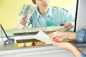 stock photo of cashiers  - Teller window with working cashier  - JPG