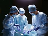 foto of surgeons  - Team surgeon at work in operating room - JPG
