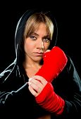 Постер, плакат: Young Sexy Dangerous Boxing Girl Wrapping Hands And Wrists Female Combat Boxer