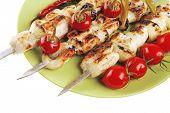 stock photo of kebab  - fresh grilled  shish kebab on green platter with vegetables - JPG