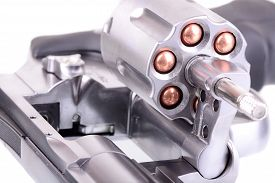 picture of revolver  - Macro shot of an open revolver loaded with bullets - JPG