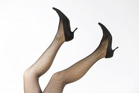 foto of fishnet stockings  - a sexy pair of legs with fishnet stocking and high heels - JPG
