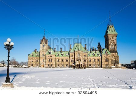 Ottawa Parliament buildings, East Block, on a clear winter day. Deep snow lays on the ground.