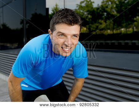 Young Attractive Man Leaning Exhausted After Running Session Sweating Taking A Break To Recover In U