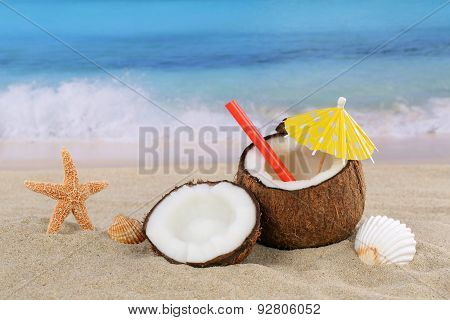 Coconut Fruit Cocktail Drink In Summer On The Beach And Sea