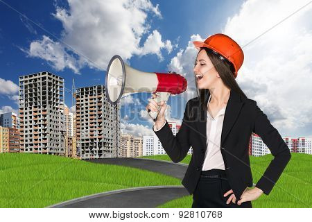 Woman in hardhat with megaphone