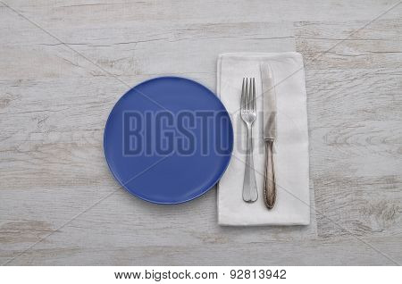 Plate, Cutlery And Cloth On Wood