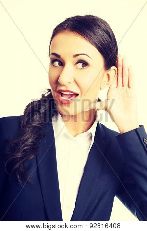 Portrait of young beautiful businesswoman overhears.