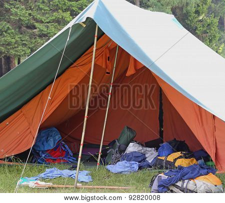 Tent Of Boy Scout Camp With Backpacks And Sleeping Bags Spread Out