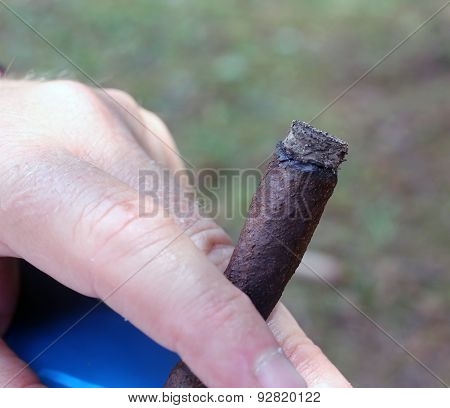 Hand Of Smoker With The Cigar