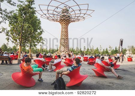 People Sitting  In Front Of Tree Of Life At Expo 2015 In Milan, Italy