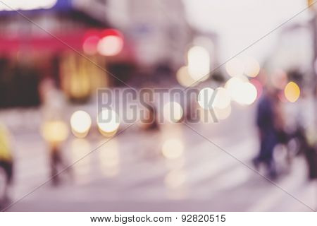 people walking on street in urban city, defocused image, city scene