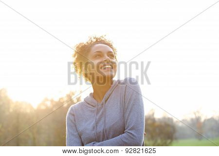 Happy Young Woman Thinking And Looking Up