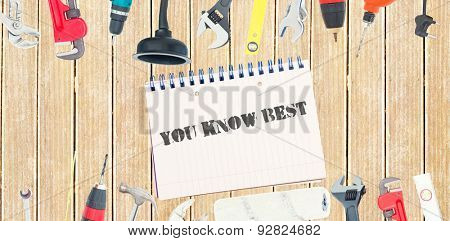 The word you know best against tools and notepad on wooden background