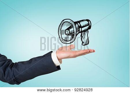 Hand presenting against blue vignette background