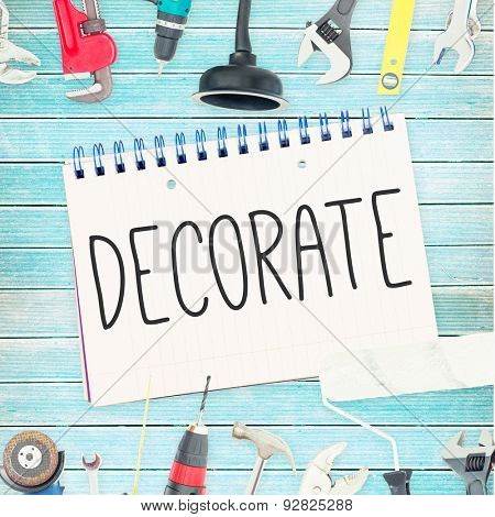 The word decorate against tools and notepad on wooden background