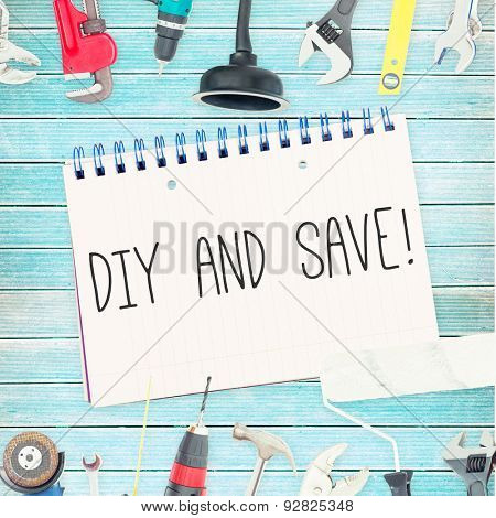The word diy and save! against tools and notepad on wooden background