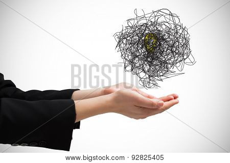 Businesswomans hands presenting against white background with vignette